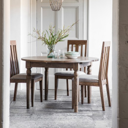 Rustic oak extending dining table round
